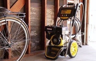 Gas Pressure Washer from Champion on a long-term storage in a garage.